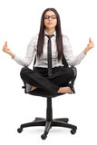 Businesswoman meditating seated on a chair Royalty Free Stock Image
