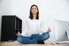 Businesswoman meditating at the table Royalty Free Stock Photos