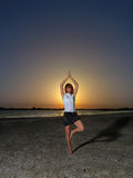 Businesswoman meditating yoga position  sunset Stock Photography