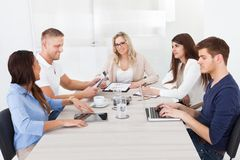 Businesswoman in meeting with colleagues Stock Images