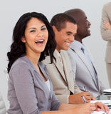 Businesswoman in a meeting smiling Royalty Free Stock Photography