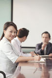 Businesswoman in Meeting Smiling At Camera Royalty Free Stock Photos