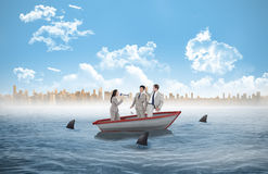 Businesswoman with megaphone yelling at colleagues in a sailboat Stock Images