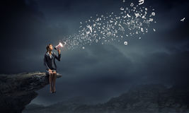 Businesswoman with megaphone Stock Images