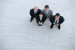 Businesswoman and men looking up Royalty Free Stock Photos