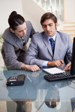 Businesswoman mentoring her new colleague. Young businesswoman mentoring her new colleague Royalty Free Stock Image