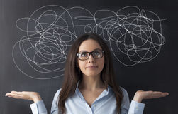 Businesswoman Mess on Blackboard Stock Photography