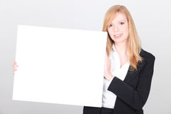 Businesswoman with a message board Royalty Free Stock Images