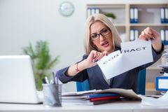 The businesswoman with message in office at desk. Businesswoman with message in office at desk Royalty Free Stock Photos