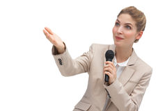 Businesswoman with microphone pointing at something. With her hands stock photos
