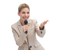 Businesswoman with microphone showing something Royalty Free Stock Image
