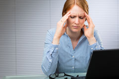Businesswoman with Migraine or Headache Royalty Free Stock Images