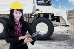Businesswoman and a mining truck at mining site Stock Photography