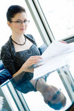 Businesswoman with mirroring on a table Stock Images