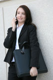 Businesswoman with mobile Stock Images
