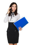 Businesswoman with mobile. Young slim businesswoman hold folder and speak mobile Stock Photo