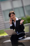 Businesswoman with a mobile royalty free stock photos