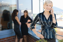 Businesswoman on mobile Stock Images