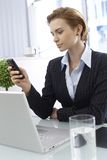 Businesswoman with mobile Royalty Free Stock Image