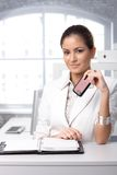 Businesswoman with mobile and organizer Royalty Free Stock Photography