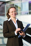 Businesswoman with a mobile phone. Royalty Free Stock Photography