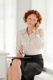 Businesswoman with mobile phone. Stock Images