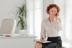 Businesswoman with mobile phone. Royalty Free Stock Photos