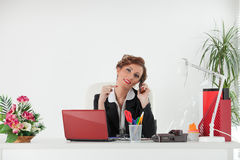 Businesswoman with mobile phone. Stock Image