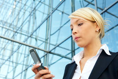 Businesswoman with mobile phone Stock Photography