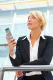 Businesswoman with mobile phone Royalty Free Stock Photos