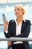 Businesswoman with mobile phone Stock Images