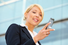 Businesswoman with mobile phone Stock Image