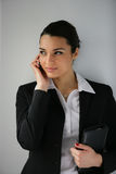 Businesswoman with mobile phone. Portrait of a businesswoman speaking on a mobile phone Royalty Free Stock Images