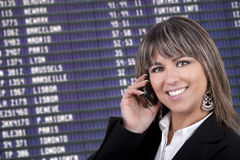 Businesswoman with mobile phone in airport stock image