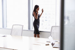 Businesswoman On Mobile Phone In Boardroom Stock Images