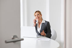 Businesswoman On Mobile Phone In Boardroom Royalty Free Stock Images