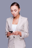 Businesswoman with mobile phone. Stock Photography