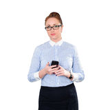 Businesswoman with mobile phone in hand. Royalty Free Stock Photos