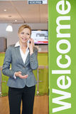 Businesswoman On Mobile Phone By Office Entrance Royalty Free Stock Photos