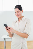 Businesswoman with mobile phone in office Royalty Free Stock Photos