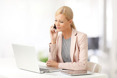 Businesswoman with mobile phone Royalty Free Stock Image