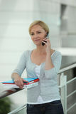 Businesswoman on mobile telephone Royalty Free Stock Images