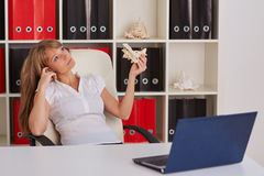 Businesswoman with a  model of plane. Royalty Free Stock Images