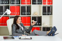 Businesswoman with a  model of plane. Stock Photo