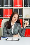 Businesswoman with a  model of plane. Stock Images