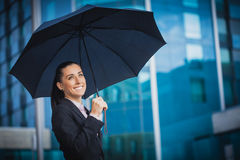 Businesswoman, on the modern building background Royalty Free Stock Images