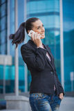 Businesswoman, on the modern building background Stock Photography