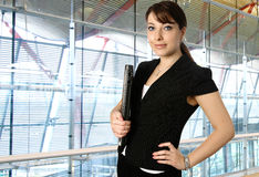 Businesswoman in a modern corporate office Stock Images