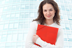 Businesswoman on modern glass building Stock Photo