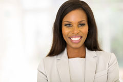Businesswoman in modern office Stock Images